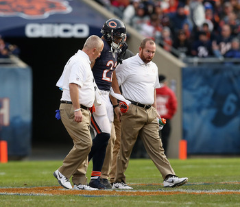 CHICAGO, IL - NOVEMBER 25: Matt Forte #22 of the Chicago Bears is helped off of the field after an injury against the Minnesota Vikings at Soldier Field on November 25, 2012 in Chicago, Illinois. The Bears defeated the Vikings 28-10. (Photo by Jonathan Da