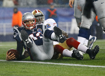 Patriot's quarterback Tom Brady was sacked three times Sunday night.