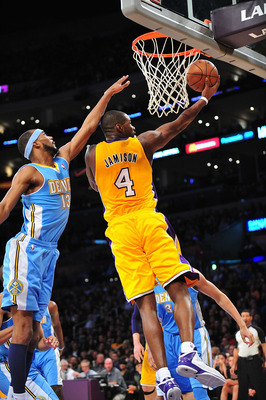 November 30, 2012; Los Angeles, CA, USA; Los Angeles Lakers power forward Antawn Jamison (4) scores a basket against the Denver Nuggets during the second half at Staples Center. Mandatory Credit: Gary A. Vasquez-USA TODAY Sports
