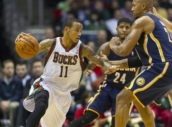 Dec 18, 2012; Milwaukee, WI, USA;  Milwaukee Bucks guard Monta Ellis (11) drives with the ball as Indiana Pacers forward David West (21) defends during the third quarter at the BMO Harris Bradley Center.  The Bucks won 98-93.  Mandatory Credit: Jeff Hanis