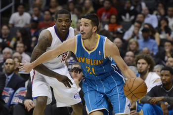 Nov 26, 2012; Los Angeles, CA, USA; New Orleans Hornets point guard Greivis Vasquez (21) dribbles the ball against Los Angeles Clippers point guard Eric Bledsoe (12) during the game at Staples Center. Mandatory Credit: Richard Mackson-USA TODAY Sports