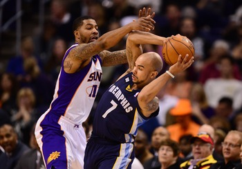 Dec. 12, 2012; Phoenix, AZ, USA: Memphis Grizzlies guard Jerryd Bayless controls the ball under pressure from Phoenix Suns forward Markieff Morris (11) in the second half at the US Airways Center. The Suns defeated the Grizzlies 82-80. Mandatory Credit: M