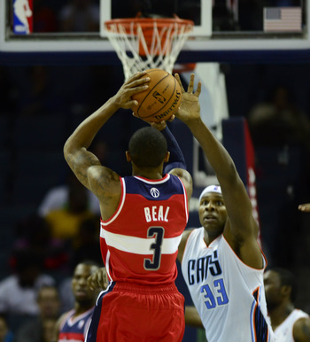 Oct 7, 2012; Charlotte, NC, USA; Washington Wizards guard Bradley Beal (3) shoots over Charlotte Bobcats center Brendan Hayward (33) during the second half at Time Warner Cable Arena.  Mandatory Credit: Curtis Wilson-USA TODAY Sports