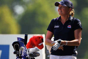 Stacy Lewis proudly displays her Razorback head cover.