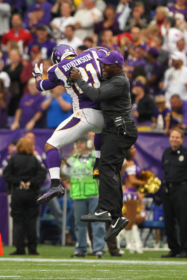 Defensive backs coach, Joe Woods, celebrates with Josh Robinson, who got the Vikings first interception of the season in Week 3, against the 49ers.