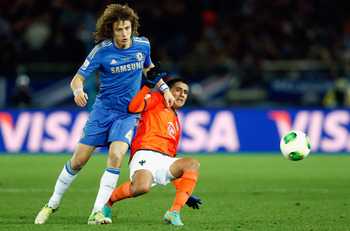 YOKOHAMA, JAPAN - DECEMBER 13:  David Luiz (L) of Chelsea challenges Darvin Chavez  (R) of CF Monterrey during the FIFA Club World Cup Semi Final match between CF Monterrey and Chelsea at International Stadium Yokohama on December 13, 2012 in Yokohama, Ja