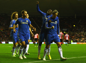 SUNDERLAND, ENGLAND - DECEMBER 08:  Fernando Torres of Chelsea is congratulated by team mates after scoring his second goal from the penalty spot during the Barclays Premier League match between Sunderland and Chelsea at Stadium of Light on December 8, 20