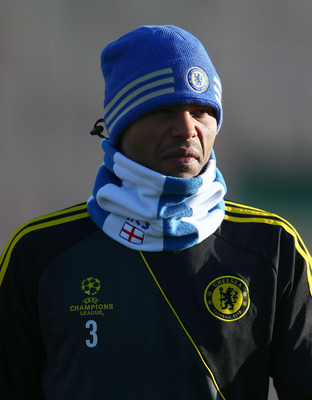 LONDON, ENGLAND - DECEMBER 04:  Ashley Cole of Chelsea looks on during a training session at Cobham training ground on December 4, 2012 in London, England.  (Photo by Clive Rose/Getty Images)