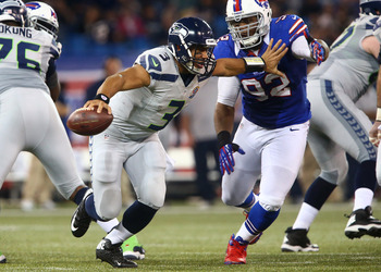 Russell Wilson ran for 92 yards and three scores in a Week 15 win over the Bills.