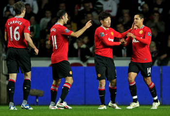 Javier Hernandez is congratulated by Manchester United teammates after his winning goal at Swansea last season