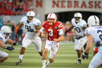 LINCOLN, NE - NOVEMBER 10: Quarterback Taylor Martinez #3 of the Nebraska Cornhuskers runs with the ball against  the Penn State Nittany Lions defense during their game at Memorial Stadium on November 10, 2012 in Lincoln, Nebraska. Nebraska beat Penn Stat
