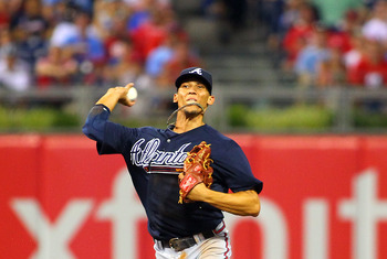 PHILADELPHIA, PA - JULY 7:  Andrelton Simmons #19 of the Atlanta Braves throws to first base to get Chase Utley of the Philadelphia Phillies out during a MLB baseball game on July 7, 2012 at Citizens Bank Park in Philadelphia, Pennsylvania. The Braves def
