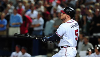 ATLANTA, GA - SEPTEMBER 25: Freddie Freeman #5 of the Atlanta Braves hits a 9th inning walk off home run against the Miami Marlins at Turner Field on September 25 2012 in Atlanta, Georgia. (Photo by Scott Cunningham/Getty Images)