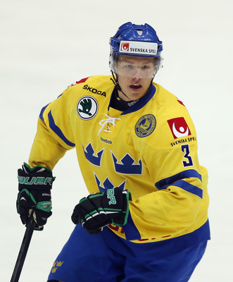 LAKE PLACID, NY - AUGUST 07:  Hampus Lindholm #3 of Team Sweden skates against Team Finland at the USA hockey junior evaluation camp at the Lake Placid Olympic Center on August 7, 2012 in Lake Placid, New York. Team Sweden defeated Finland 8-2.  (Photo by
