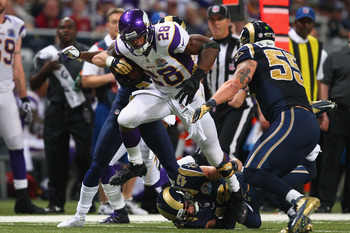 ST. LOUIS, MO - DECEMBER 16: Adrian Peterson #28 of the Minnesota Vikings slips a tackle attempt by Craig Dahl #43 the St. Louis Rams at the Edward Jones Dome on December 16, 2012 in St. Louis, Missouri.  (Photo by Dilip Vishwanat/Getty Images)