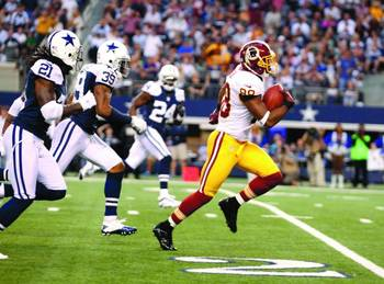 Washington carved up the Cowboys on Thanksgiving Day. (Alex Brandon/AP)