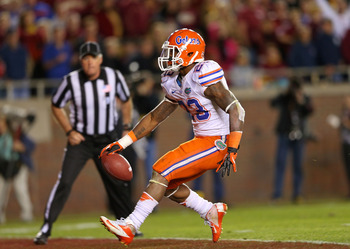 TALLAHASSEE, FL - NOVEMBER 24:  Mike Gillislee #23 of the Florida Gators scores a touchdown during a game against the Florida State Seminoles at Doak Campbell Stadium on November 24, 2012 in Tallahassee, Florida.  (Photo by Mike Ehrmann/Getty Images)