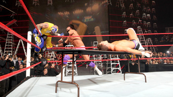 The tables match between Team Rhodes Scholars and Team SinSterio was one of the highlights of the night. Photo Courtesy of WWE.com