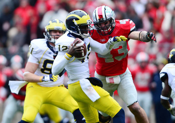 Nathan Williams puts pressure on Devin Gardner in Williams' final game as a Buckeye.