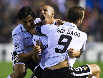 VALENCIA, SPAIN - NOVEMBER 20:   Sofiane Feghouli of Valencia celebrate scoring with his teammate Roberto Soldado (L) and Tino Costa during the UEFA Champions League group F match between Valencia  during the UEFA Champions League group F match between Va