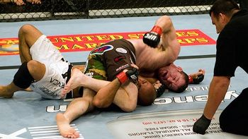 Hughes brutally avenged his loss to BJ Penn by tiring him out and dominating him on the ground. Photo c/o ESPN.com.