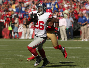 S Antrel Rolle returns an INT versus SF in Week 6.