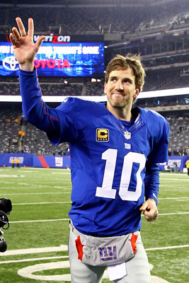 QB Eli Manning jogs off the field after setting the franchise record for career TD passes (200).