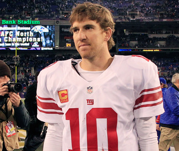 BALTIMORE, MD - DECEMBER 23:  Quarterback Eli Manning #10 of the New York Giants walks off the field following the Giants 33-14 loss to the Baltimore Ravens at M&T Bank Stadium on December 23, 2012 in Baltimore, Maryland.  (Photo by Rob Carr/Getty Images)