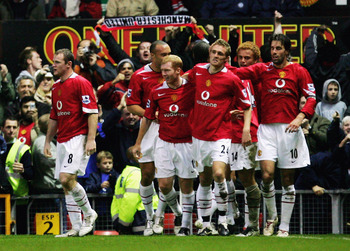 Darren Fletcher is congratulated by Manchester United teammates after his winner against Chelsea in November 2005