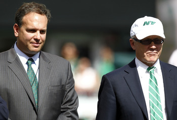 Woody Johnson (right) may make Mike Tannenbaum (left) the Jets' salary cap specialist and appoint a new general manager.