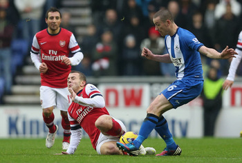 Jack Wilshere was harshly booked at Wigan