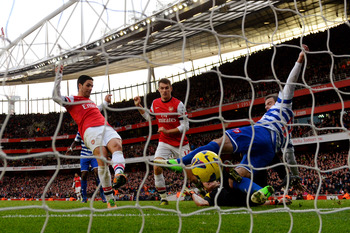 Arteta bundles the ball home against QPR