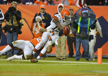 Dec 23 2012; Denver, CO, USA; Cleveland Browns wide receiver Greg Little (15) reaches for the end zone and scores during the third quarter against the Cleveland Browns at Sports Authority Field. The Broncos defeated the Browns 34-12. Mandatory Credit: Ron