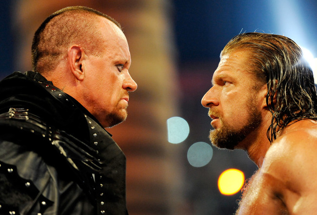 Triple-h-looking-at-the-undertaker_crop_650x440