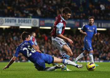 LONDON, ENGLAND - DECEMBER 23:  Eric Lichaj of Aston Villa is tackled by Cesar Azpilicueta of Chelsea during the Barclays Premier League match between Chelsea and Aston Villa at Stamford Bridge on December 23, 2012 in London, England.  (Photo by Julian Fi