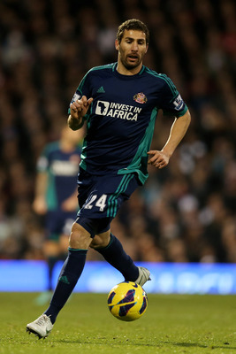 LONDON, ENGLAND - NOVEMBER 18:  Carlos Cuellar of Sunderland runs with the ball during the Barclays Premier League match between Fulham FC and Sunderland AFC at Craven Cottage on November 18, 2012 in London, England.  (Photo by Julian Finney/Getty Images)