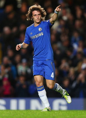 LONDON, ENGLAND - DECEMBER 23:  David Luiz of Chelsea celebrates as he scores their second goal during the Barclays Premier League match between Chelsea and Aston Villa at Stamford Bridge on December 23, 2012 in London, England.  (Photo by Clive Rose/Gett