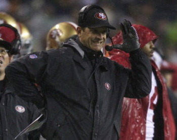 SEATTLE, WA - DECEMBER 23: San Francisco 49ers head coach Jim Harbaugh reacts to a Seattle Seahawks touchdown during a game at CenturyLink Field on December 23, 2012 in Seattle, Washington.  (Photo by Stephen Brashear/Getty Images)