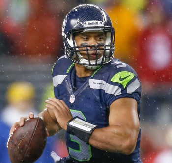 SEATTLE, WA - DECEMBER 23:  Quarterback Russell Wilson #3 of the Seattle Seahawks rolls out to pass against the San Francisco 49ers at CenturyLink Field on December 23, 2012 in Seattle, Washington.  (Photo by Otto Greule Jr/Getty Images)