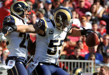 TAMPA, FL - DECEMBER 23: Linebacker James Laurinaitis #55 of the St. Louis Rams celebrates after a second quarter interception against the Tampa Bay Buccaneers December 23, 2012 at Raymond James Stadium in Tampa, Florida. (Photo by Al Messerschmidt/Getty