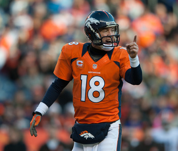 DENVER, CO - DECEMBER 23:  Quarterback Peyton Manning #18 of the Denver Broncos audibles out of the shotgun during a game against the Cleveland Browns at Sports Authority Field at Mile High on December 23, 2012 in Denver, Colorado. The Broncos defeated th