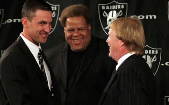 ALAMEDA, CA - JANUARY 30:  New Oakland Raiders head coach Dennis  Allen (L) greets Raiders general manager Reggie McKenzie (C) and team owner Mark Davis during a press conference on January 30, 2012 in Alameda, California. Dennis Allen was introduced as t