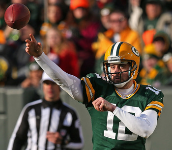 GREEN BAY, WI - DECEMBER 23: Aaron Rodgers #12 of the Green Bay Packers throws a pass against the Tennessee Titans at Lambeau Field on December 23, 2012 in Green Bay, Wisconsin. The Packers defeated the Titans 55-7. (Photo by Jonathan Daniel/Getty Images)