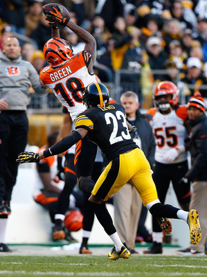 PITTSBURGH, PA - DECEMBER 23: A.J. Green #18 of the Cincinnati Bengals catches a pass in front of Keenan Lewis #23 of the Pittsburgh Steelers that lead to the game-winning field goal in the fourth quarter during the game at Heinz Field on December 23, 201