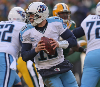 GREEN BAY, WI - DECEMBER 23: Jake Locker #10 of the Tennessee Titans rolls out to look for a receiver against the Green Bay Packers at Lambeau Field on December 23, 2012 in Green Bay, Wisconsin. The Packers defeated the Titans 55-7. (Photo by Jonathan Dan