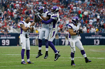 HOUSTON, TX - DECEMBER 23:  Minnesota Vikings players celebrate late in the fourth quarter during the game against the Houston Texans at Reliant Stadium on December 23, 2012 in Houston, Texas.  (Photo by Scott Halleran/Getty Images)