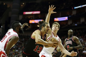 Nov 21, 2012; Houston, TX, USA; Chicago Bulls center Joakim Noah (13) drives against Houston Rockets shooting guard James Harden (13) and center Omer Asik (3) during the third quarter at the Toyota Center. Mandatory Credit: Thomas Campbell-USA TODAY Sport