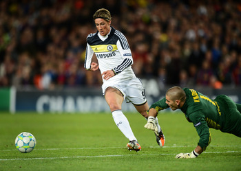 Fernando Torres taking the ball past Victor Valdes for THAT goal.
