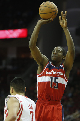 Dec 12, 2012; Houston, TX, USA; Washington Wizards shooting guard Jordan Crawford (15) shoots over Houston Rockets point guard Jeremy Lin (7) during the first quarter at the Toyota Center. Mandatory Credit: Thomas Campbell-USA TODAY Sports
