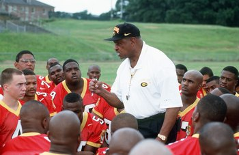GRAMBLING,LA - AUGUST 13:  Head Coach Eddie Robinson of Grambling State University talks with his team during Media Day at Robinson Stadium in Grambling, Louisiana.  (Photo by: Stephen Dunn/Getty Images)